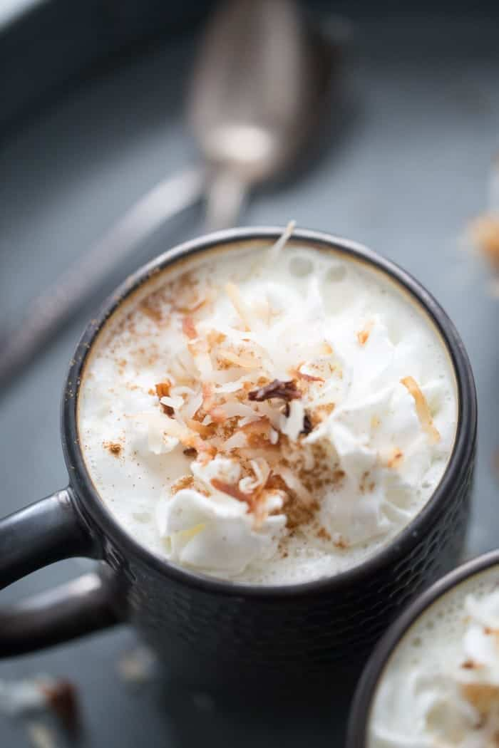 You can't believe how easy it is to make your own white hot chocolate! This recipe is topped with toasted coconut! lemonsforlulu.com