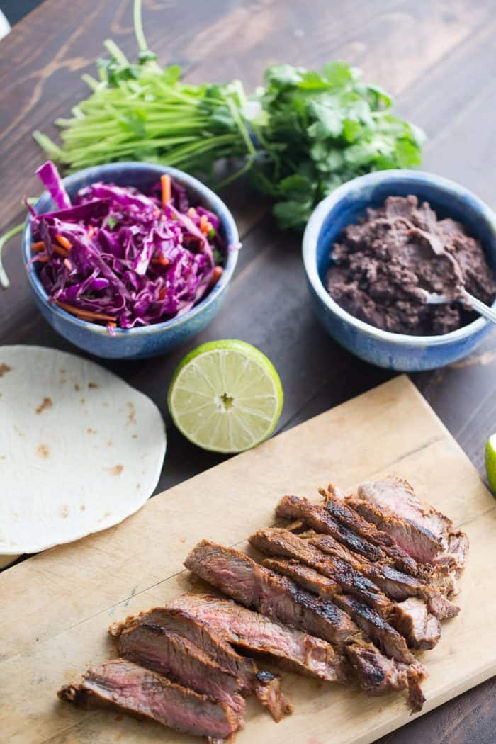 Grilled steak is seasoned with a smoky rub then combined with a garlic bean mixture and a honey lime coleslaw! East and west collide in each bite!