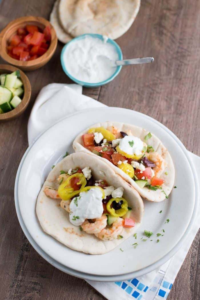 This gyro sandwich is a little different. Creamy, garlic shrimp is placed inside pita rounds them topped with fresh vegetables, feta and a homemade tzatziki sauce!