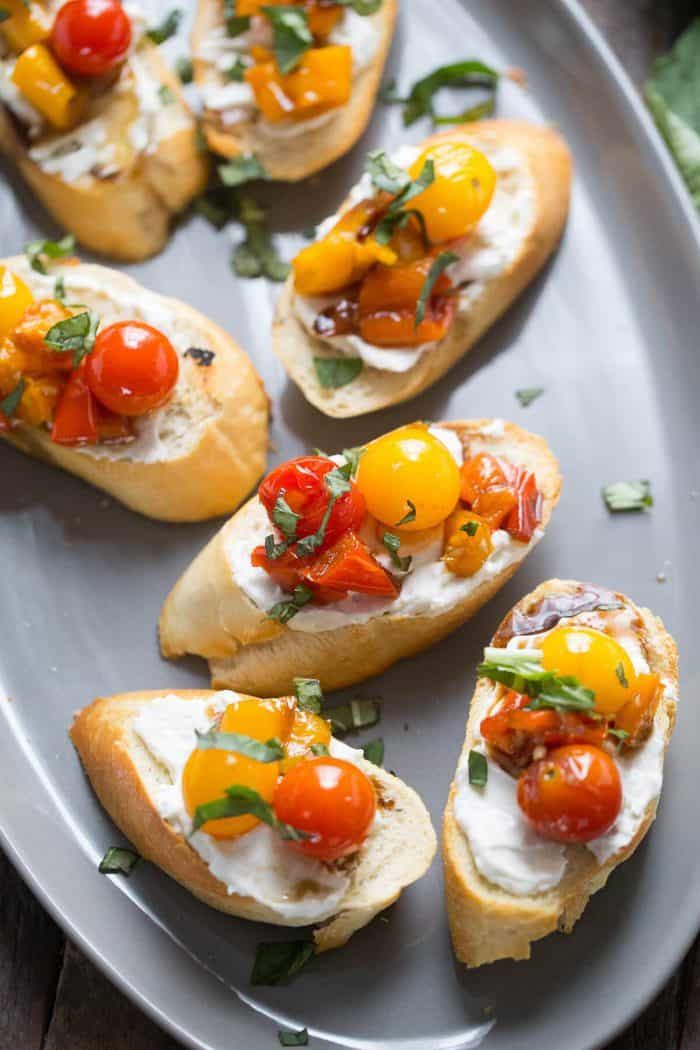 This bruschetta recipe looks so impressive with the colorful roasted veggies and creamy whipped feta!