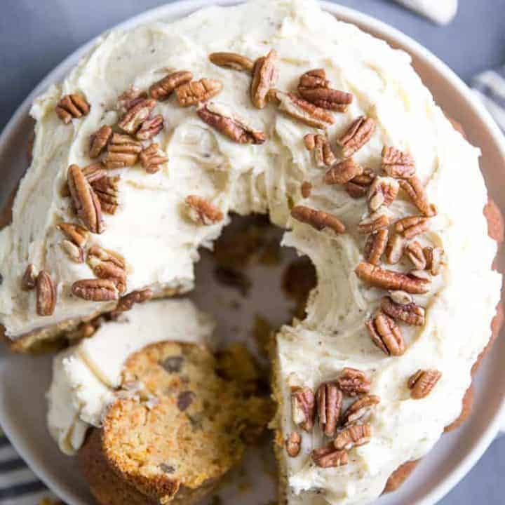 Homemade carrot cake recipe with slice on its side