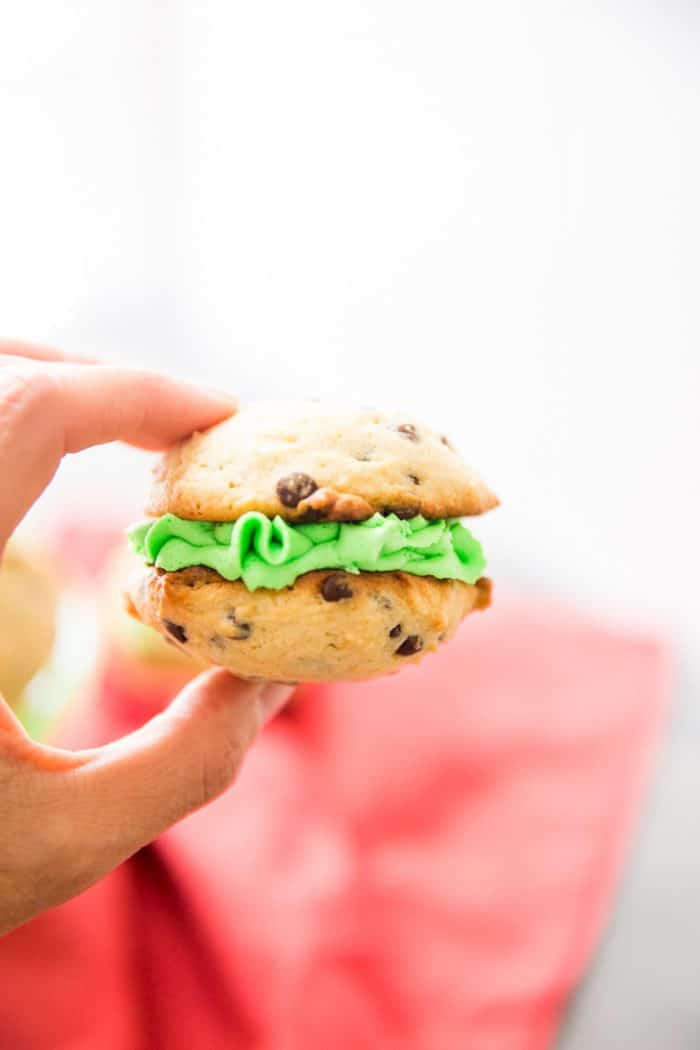 Fingers holding mint chocolate chip whoopie pie