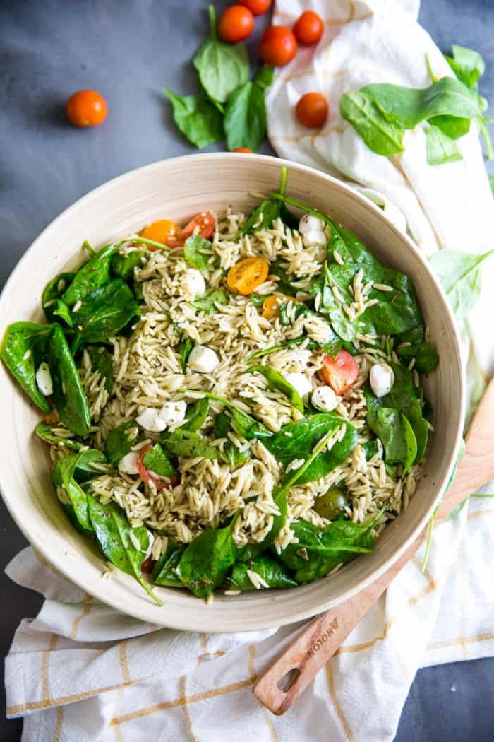 Orzo salad bowl with veggies on the side