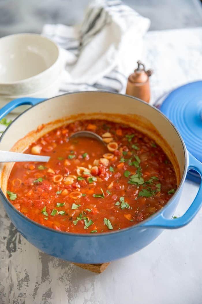 pasta e fagipoli with a silver ladle