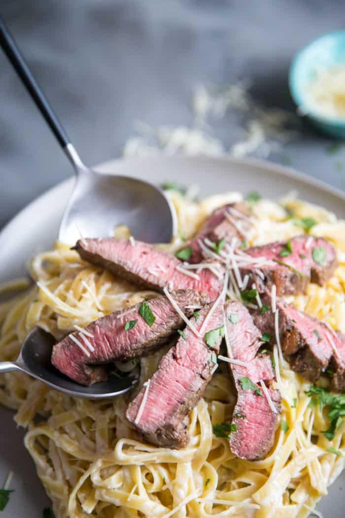 steak alfredo being served