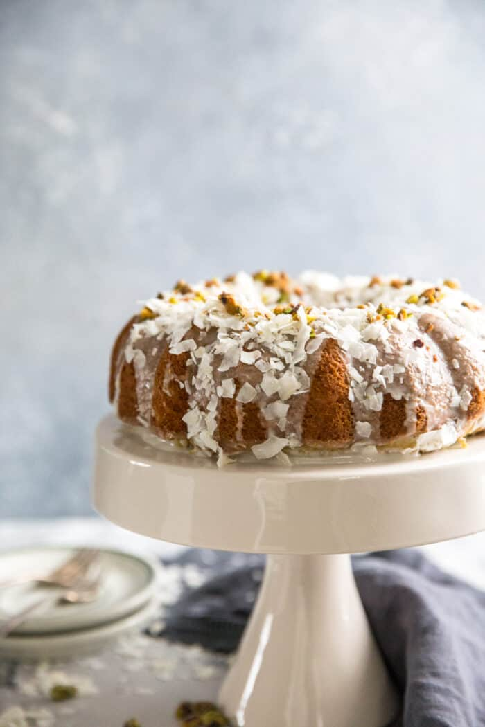 pistachio cake on cake stand