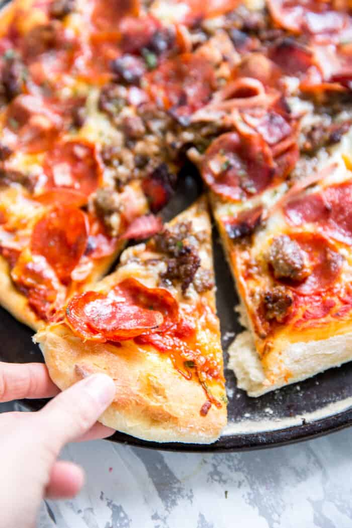 Italian pizza slice being pulled away