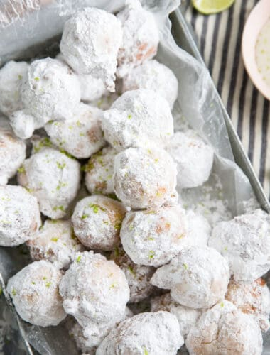 fried donuts with powdered sugar