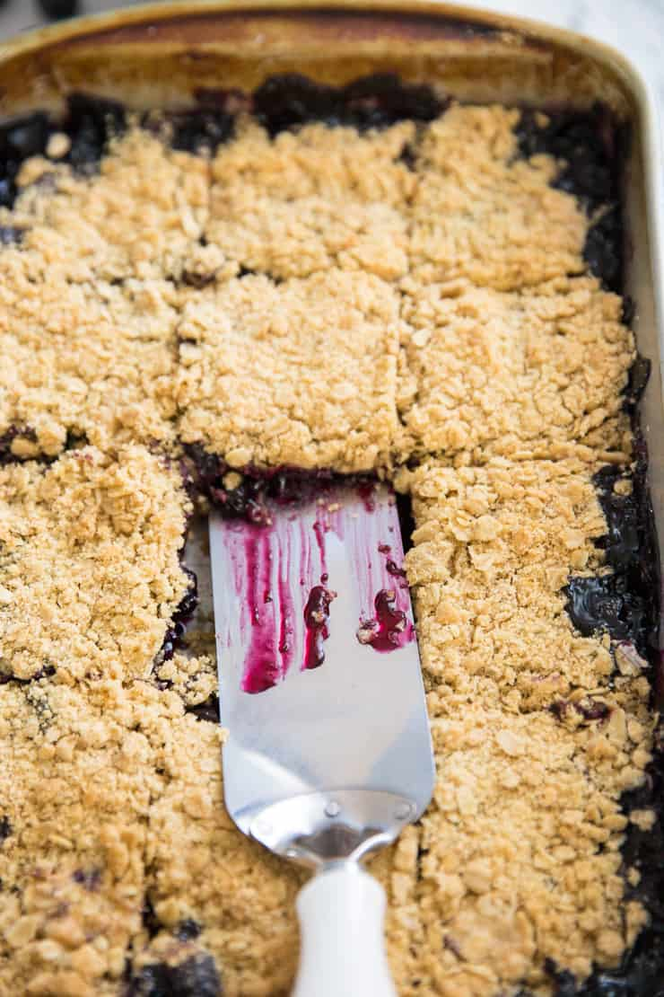 blueberry oatmeal bars with a spatula in the center