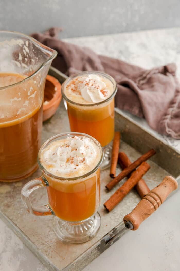 hot buttered rum glasses and pitcher on a silver tray