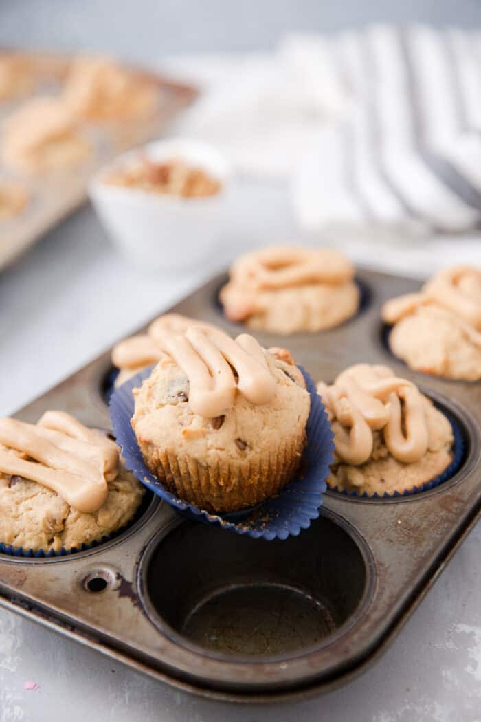 one banana muffin in a blue paper cup