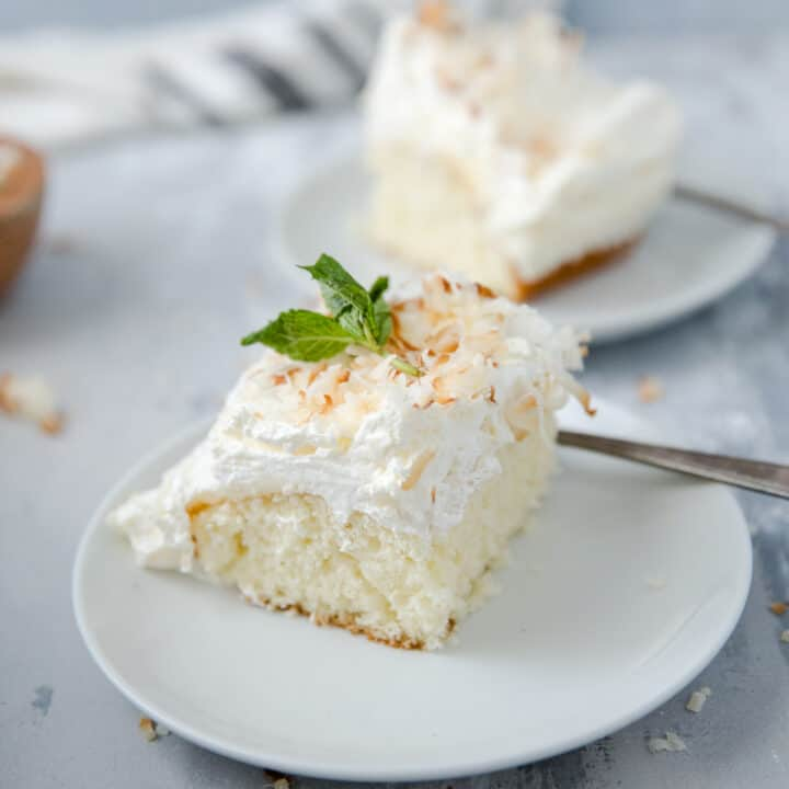 slice of coconut cake on a white plate