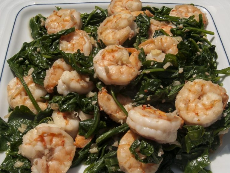 Crispy sauteed sesame shrimp with spinach. A quick and easy dinner cone in 15 minutes.