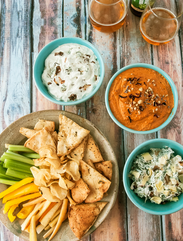 Three recipes, Spinach and Artichoke Dip with Bacon, Roasted Red Pepper Dip with Walnuts and Pomegranate, Blue Cheese Dip with Caramelized Shallots
