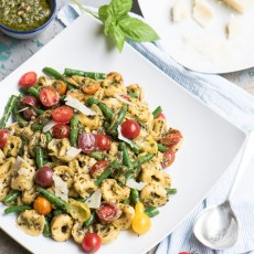Tortellini with basil pesto, grape tomatoes and green beans recipe.
