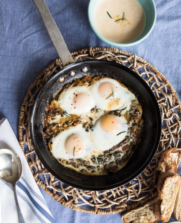 Baked Eggs with Sauteed Greens and Zesty Yogurt Sauce
