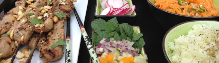 Vietnamese Pork skewers with fine diced veggies, sliced radishes, pickled carrots and rice.