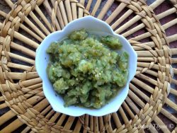 Overhead shot of Salsa Verde in a white bowl on wicker placemat