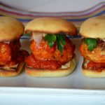 A trio of Chicken Parmesan Meatball Sliders on a white plate.