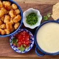 Game Day Appetizer of Homemade Queso Dip with Tater Tots