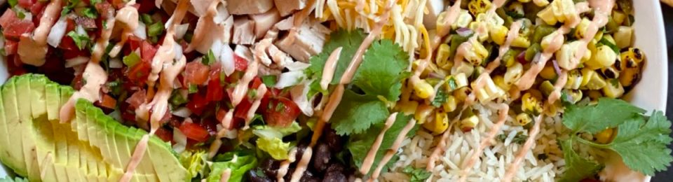 A gorgeous loaded chicken burrito bowl with all the toppings.
