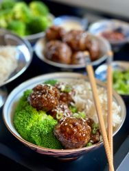 Meatball Beef & Broccoli over white rice with a sticky sweet spicy sauce.