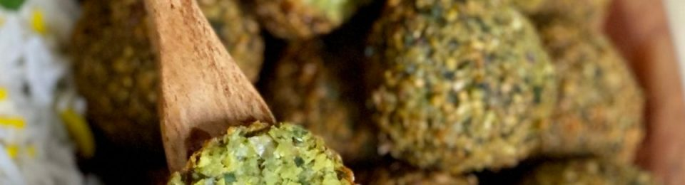 Falafel with lemon tahini dipping sauce are bright green and very flavorful.