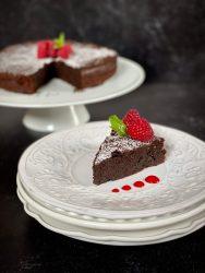gluten free flourless chocolate cake with fresh raspberries