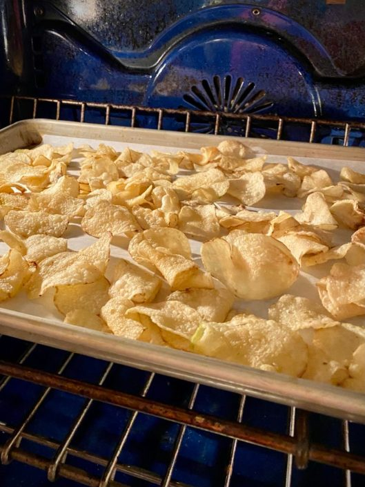 Kettle Chips warmed in the oven on a baking sheet