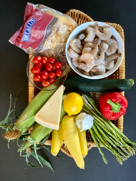 Shrimp & Summer Veggies in basket with Pappardelle Pasta