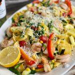 15 Minute Easy Shrimp & Summer Veggie Pappardelle Pasta on white platter sitting on wooden table.