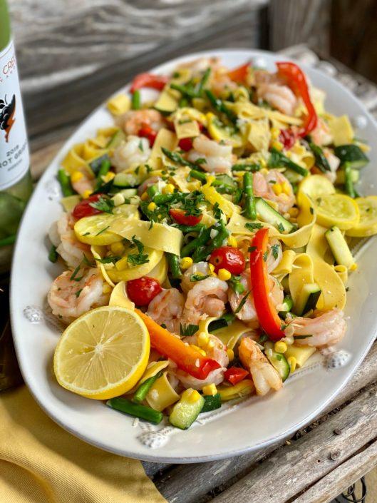 15 Minute Easy Shrimp & Summer Veggie Pappardelle Pasta on white platter sitting on wooden table