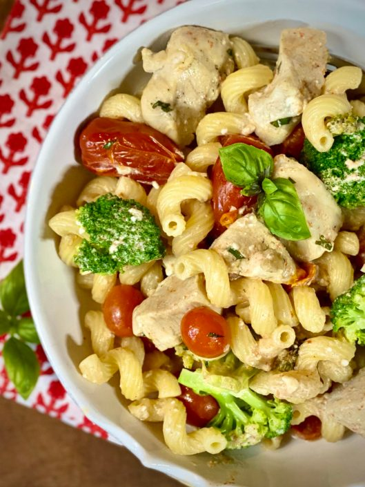Baked Feta & Tomato Pasta with Chicken & Broccoli in a white bowl
