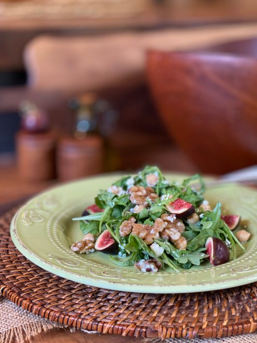 Fig and Walnut Arugula Salad with Chickpeas and Gorgonzola on a lovely green plate