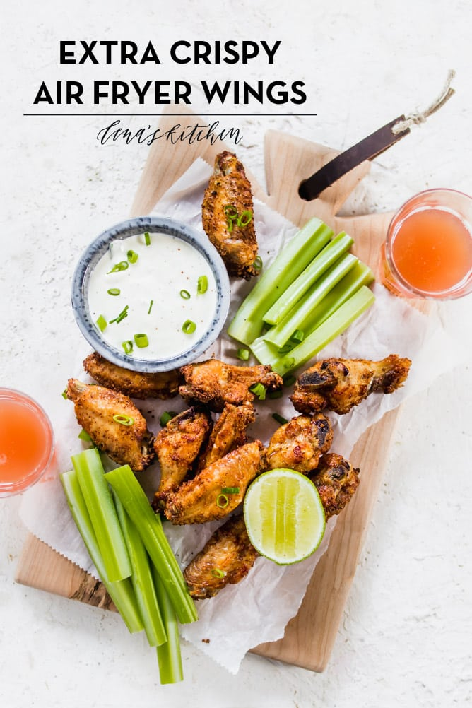 Extra Crispy Air Fryer Wings with celery and homemade ranch sauce on board with beer. lenaskitchenblog.com
