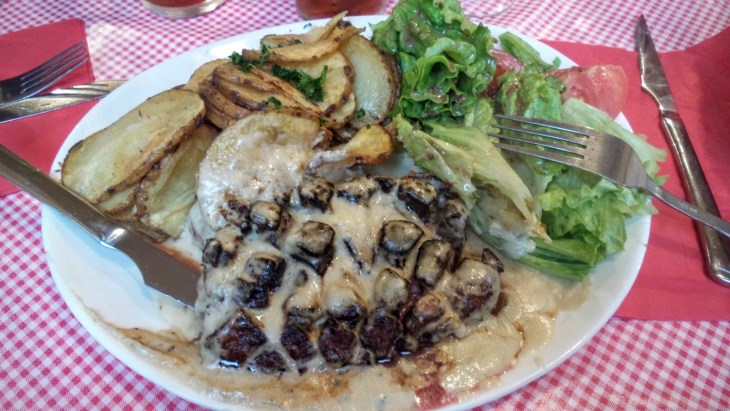 Duck with roquefort sauce. Sounds weird, looks odd, tastes great.