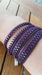 A bracelet made from a zipper.