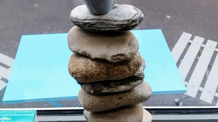Pile of stones with coffe cup on top