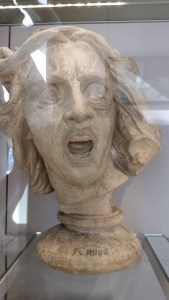 the head of a statue making an expression that is both disgusted and surprised