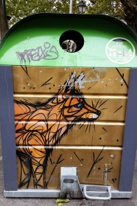 A rubbish bin with a fox painted on it