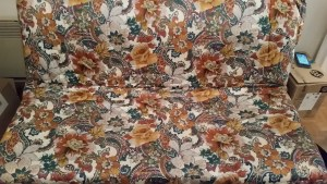 our sofa with an ugly pattern of green, mustard and brownish orange