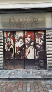 The windows of a bar called Bastide are painted with people in a ballroom in black, white and red