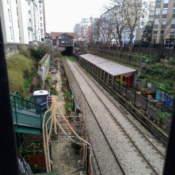 The Ruisseau garden is on the left side of the tracks. The right side belongs to the Recyclerie. I have no clue what the long tubes are that go down from the stairs to the bottom