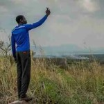 An African tries to get a GSM signal
