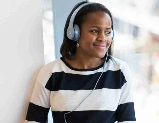 Woman listening to music streaming service Spotify