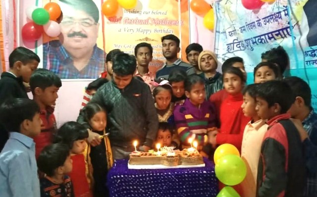 People celebrated birthday of parimal Nathwani by cutting cake and distributing sweets.