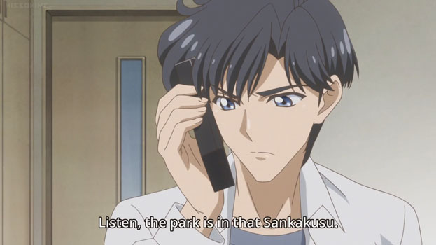 "Mamoru on the phone. He looks annoyed. Text: ""Listen. The park is in that Sankakusu."""