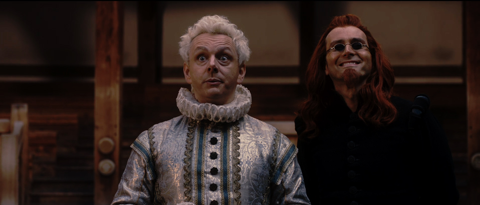 Crowley (Tennant) amused at Aziraphale (Sheen)'s attempts to disavow their friendship while standing close enough to touch.