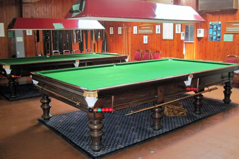 Dedicated snooker room which has two match-sized tables