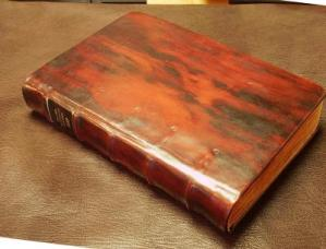 1559 Calvin commentary in full calf, with wraparound spine ribs and a rosewood finish